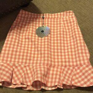 Pink checkered peplum skirt